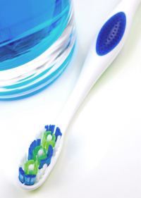 Photo of toothbrush and glass